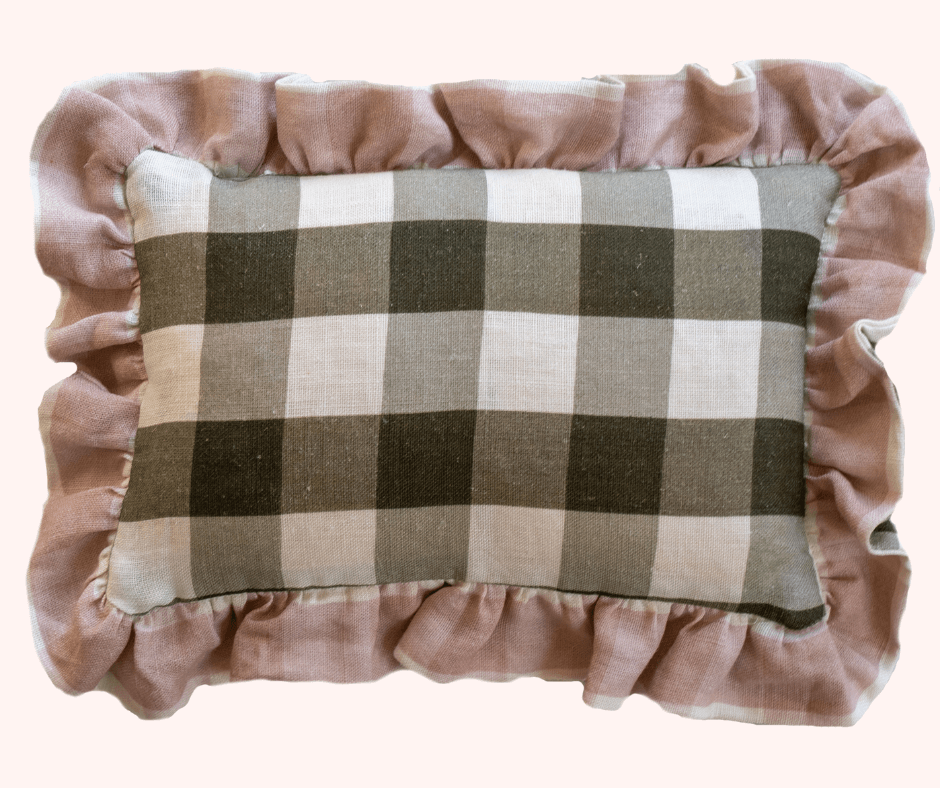 A plush cushion in large grey gingham with a velvet pink trim by Lisa Mehydene, founder of edit58. Image for her interview with La Basketry
