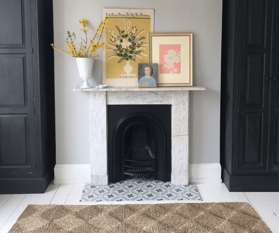 Lisa Mehydene from edit58's fireplace featuring a woven rug, picture frames and dried flowers in a vase on the mantle