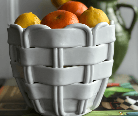 a white ceramic woven fruit bowl that looks like a basket from Sophie Douglas, founder of one off piece in her la basketry interview