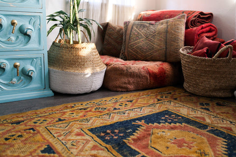 alina mendoza's styling a small 400sqft space with baskets and moroccan rugs for basket finds la basketry
