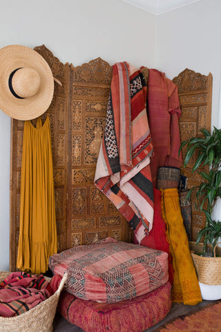 alina mendozas small space styling of a wodden screen, fabrics and baskets for basket finds la basketry