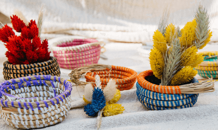 a group of handwoven miniature baskets made in the la basketry online workshop shown in multiple colours