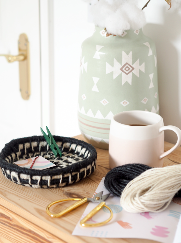 a black and white basket woven with la basketry twine basket kit to make at home
