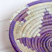 close up of the gina basket storage bowl in purple and white from la basketry showing star pattern and natural fibres