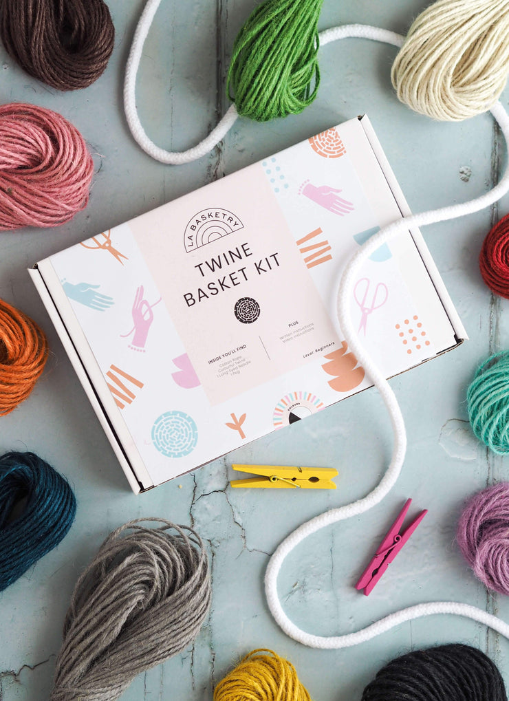 a craft diy box to make your own twine storage basket displayed with bundles of colourful twine