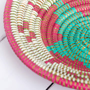 la basketry anne handwoven basket storage bowl pink and turquoise showing close up of beautiful star like pattern