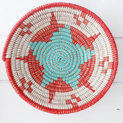la basketry anta storage bowl in red white and turquoise with beautiful woven star pattern, handmade by artisans in senegal