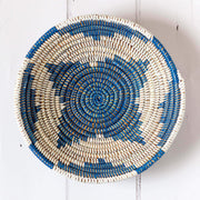 la basketry handwoven storage bowl in blue and white pattern shown from the top view showing the star like pattern of the weave