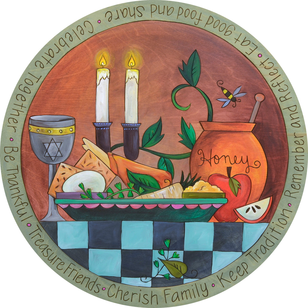 A Sincerely, Sticks printed lazy susan with a beautifully set table depicts a traditional Judaic meal