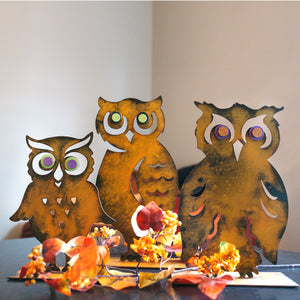 "Horned Owl Sculpture – ""Owl"" you need for charming fall decor is this side profile owl sculpture that pairs great with pumpkin sculptures displayed with other owls in a home"