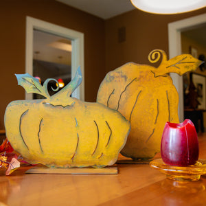 Brady Pumpkin Sculpture – Short and plump pumpkin sculpture is the perfect versatile fall decoration that can be used all season long and especially for Halloween and Thanksgiving displayed on a kitchen table