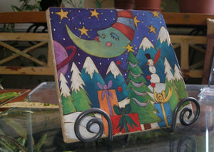 Christmas Marble Trivet – Christmas tree and gifts in a starry night winter scene on a marble trivet to serve on for the holiday season main view