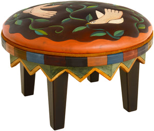 Round Ottoman –  Handsome ottoman in a classic palette with birds and twisting vines artwork main view