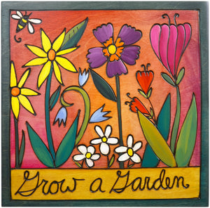 "Sticks handmade wall plaque with ""Grow a Garden"" quote and floral imagery"
