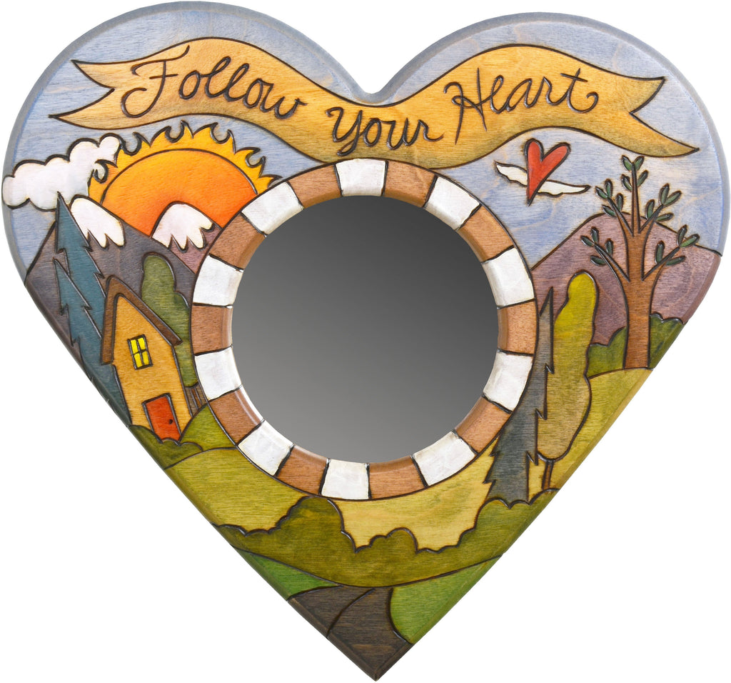 "Heart Shaped Mirror –  ""Follow your Heart"" heart-shaped mirror with sun setting over the mountain range motif"