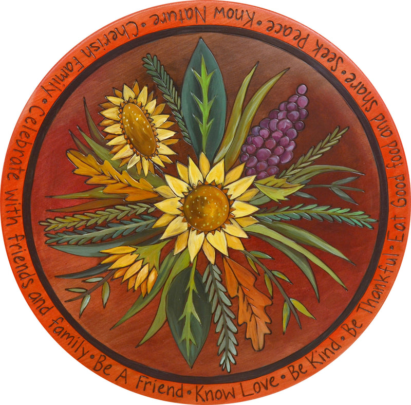 "Sticks Handmade 20""D lazy susan with lovely rich hues and late summer sunflower bouquet at the center"