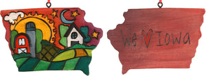 "Red-hued ""We love Iowa"" ornament with a farm landscape motif"