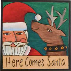 "Sticks handmade wall plaque with ""Here Comes Santa"" quote with Santa and reindeer imagery"