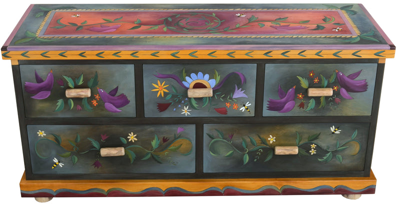 Large Dresser –  Dark dresser with bright sun and moon motif on sides