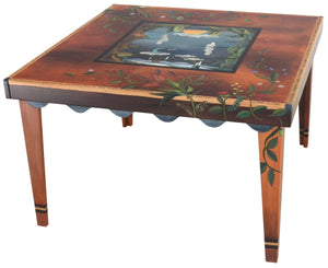 "Square Dining Table –  ""Make Each Moment Count"" dining table with sun and moon over scenes of the changing seasons motif"