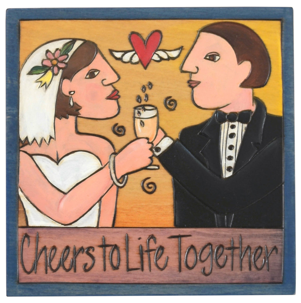 "Sticks handmade wall plaque with ""Cheers to Life Together"" quote and couple with champagne"