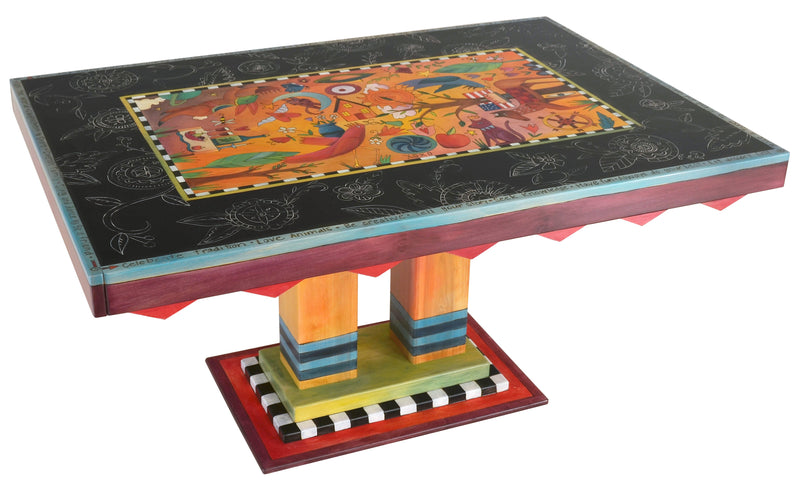 Rectangular Dining Table –  Eclectic folk art table with block floral designs and colorful floating icons and symbols in the center