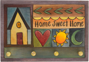 "Horizontal Key Ring Plaque –  ""Home Sweet Home"" key ring plaque with colorful block icons and patterns"