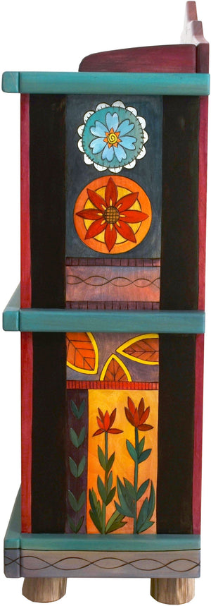 Short Bookcase –  Colorful folk art book case painted in rich hues and designed with floral motifs