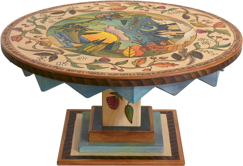 "Round Coffee Table –  ""Take Time to Smell the Flowers"" round coffee table with beautiful landscape of the changing seasons motif"