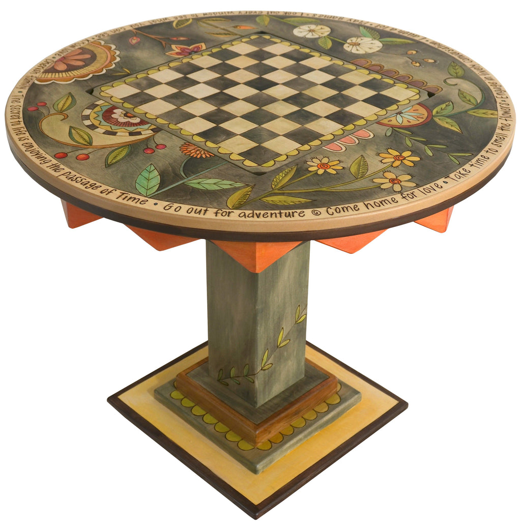"Flip-Top Game Table –  ""Go Out for Adventure/Come Home for Love"" flip-top game table with checkerboard surrounded by beautiful floral motif"