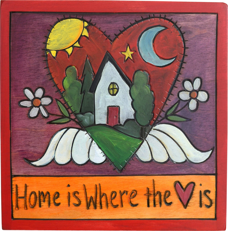 "Sticks handmade wall plaque with ""Home is Where the Heart is"" quote and heart with wings motif"
