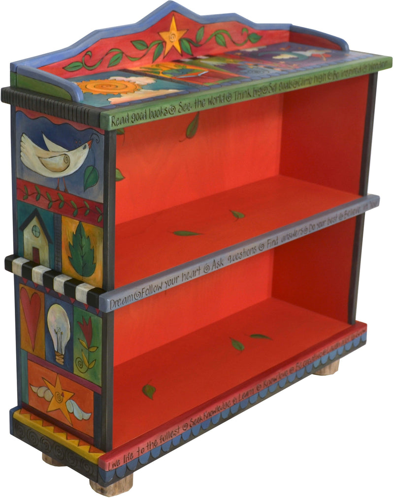 Short Bookcase –  Colorful bookcase with symbolic block icons painted in rich hues