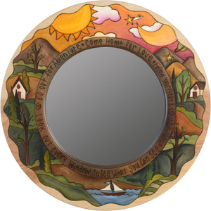 "Small Circle Mirror –  ""Go Out for Adventure/Come Home for Love"" circle mirror with sun and moon over a hilly horizon motif"