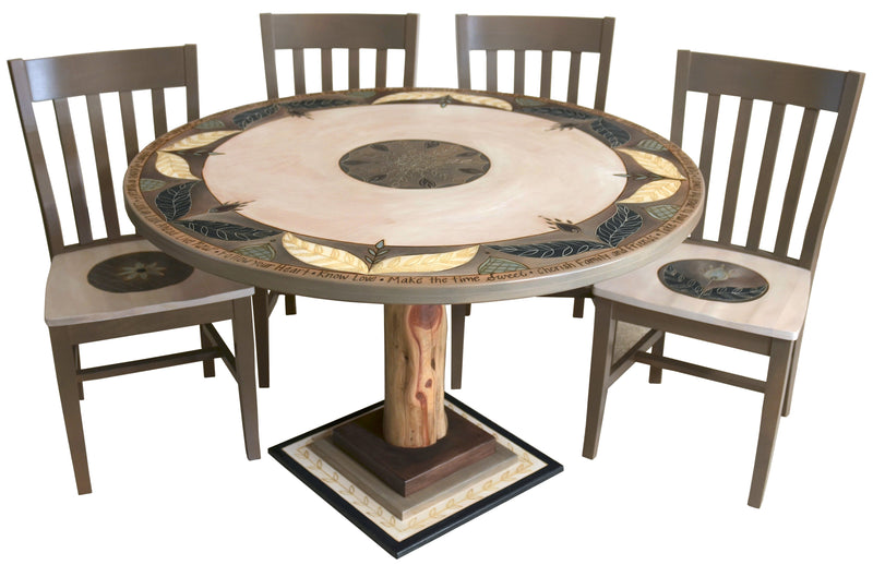 Sticks handmade dining table with elegant floral design and matching chairs