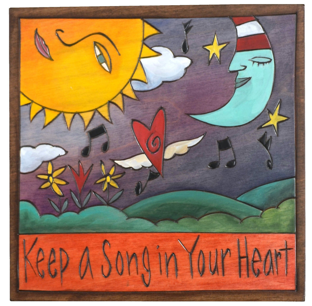 "Sticks handmade wall plaque with ""Keep a Song in Your Heart"" quote and sun and moon motif"