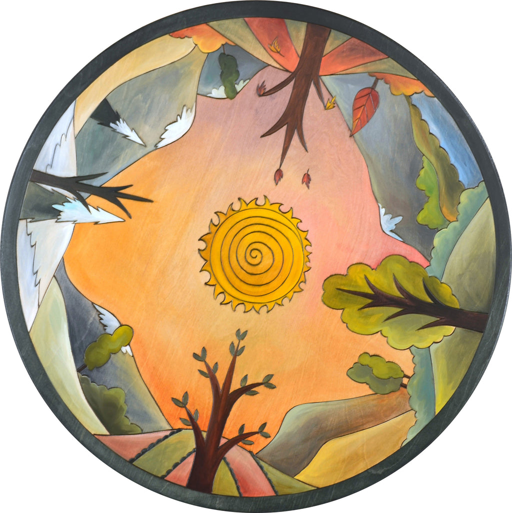 "Sticks Handmade 24""D lazy susan with symmetrical landscape design and sun in the center"