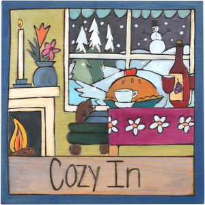 "Sticks handmade wall plaque with ""Cozy In"" quote and winter holiday scene with fireplace, wine, pie and a picture window"