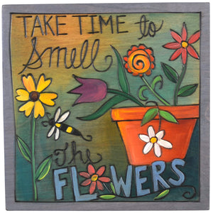 "Sticks handmade wall plaque with ""Take Time to Smell the Flowers"" quote and floral garden theme"
