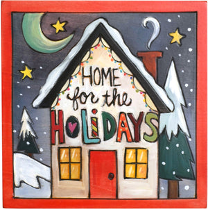 "Sticks handmade wall plaque with ""Home for the Holidays"" quote and colorful house lit with Christmas lights"