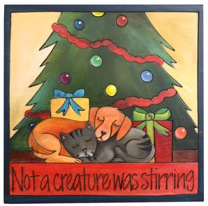 "Sticks handmade wall plaque with ""Not a creature was stirring"" quote and a cat and a dog sleeping together under the Christmas tree with presents"