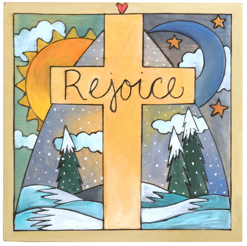 "Sticks handmade wall plaque with ""Rejoice"" quote and cross on a snowy winter landscape"