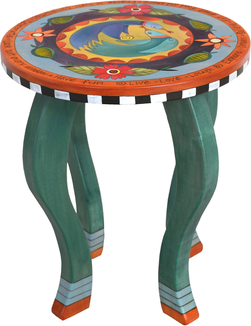 Round End Table –  Lovely end table with richly painted hues and floral motifs