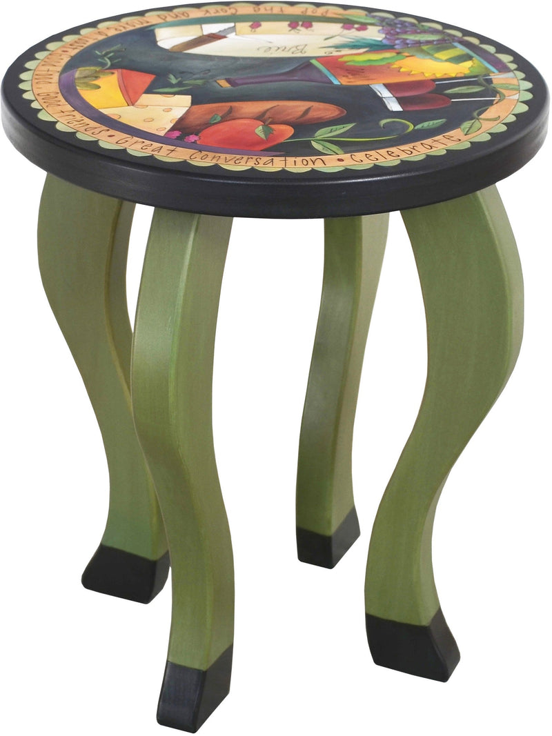 Round End Table –  Handsomely painted end table with banquet imagery