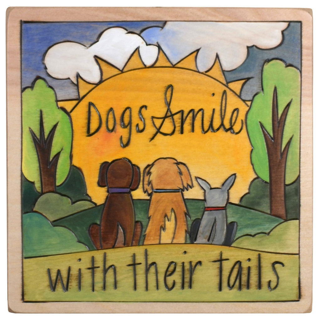 "Sticks handmade wall plaque with ""Dogs Smile with their tails"" quote and dogs in front of a sun imagery"