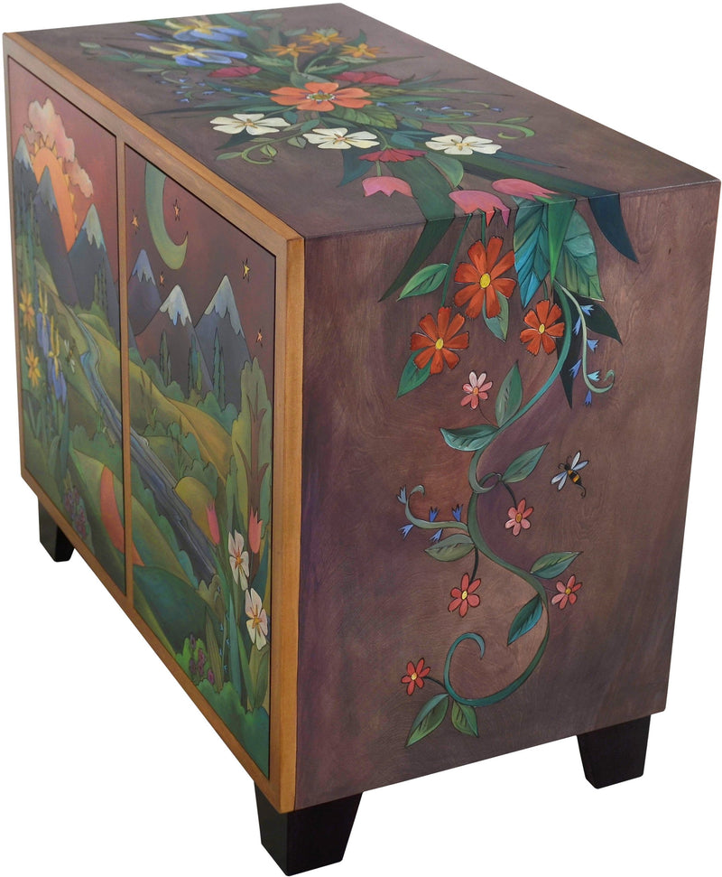 Media Buffet –  Gorgeous media cabinet featuring rolling mountains and foothills landscape with sun and moon and wildflowers