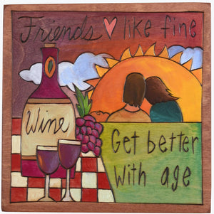 "Sticks handmade wall plaque with ""Friends, like fine wine, get better with age"" quote and sunset picnic imagery"
