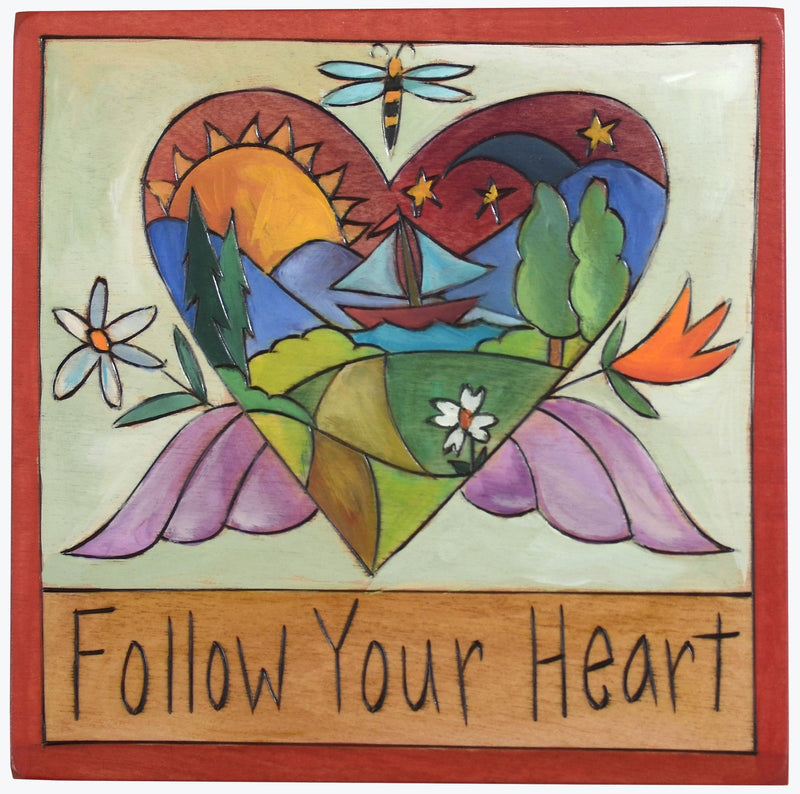 "Sticks handmade wall plaque with ""Follow your heart"" quote and heart with wings imagery"