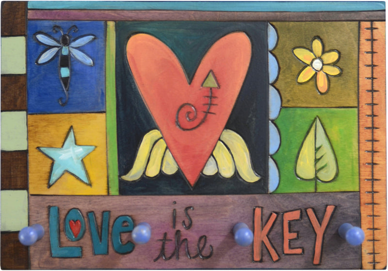 "Horizontal Key Ring Plaque –  ""Love is the Key,"" key ring plaque with colorful block icons"