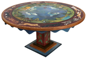 "72"" Round Dining Table –  ""Home is Where the Heart is"" round dining table with cats and dogs chasing one another around a beautiful landscape motif"