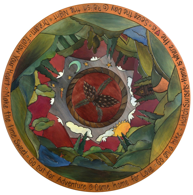 "Sticks Handmade 24""D lazy susan with rolling mountains and lake landscapes"